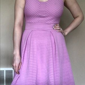 Purplish pink sleeveless dress.